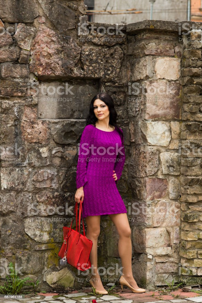 The beauty in a bright knitted dress stock photo