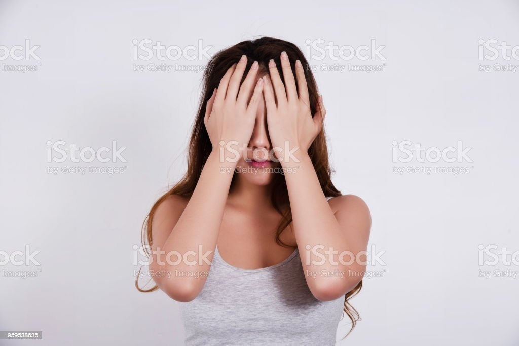 The beauty lady is raise her hands to close her eyes,the negative emotion,upset and stress feeling stock photo
