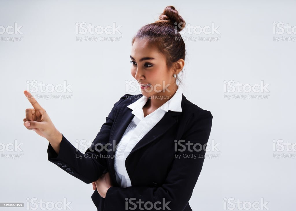 The beauty lady  with white shirt and black suit is raise finger to point at the left side of background,with smile and happy face stock photo