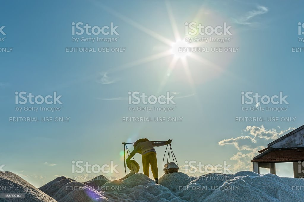 The beauty of the salt farmers workers stock photo