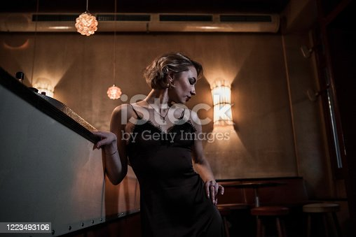 one young woman only, beauty, bar - drink establishment, fun, 1930, 1940, 1950, party, cute, portrait, waiting,