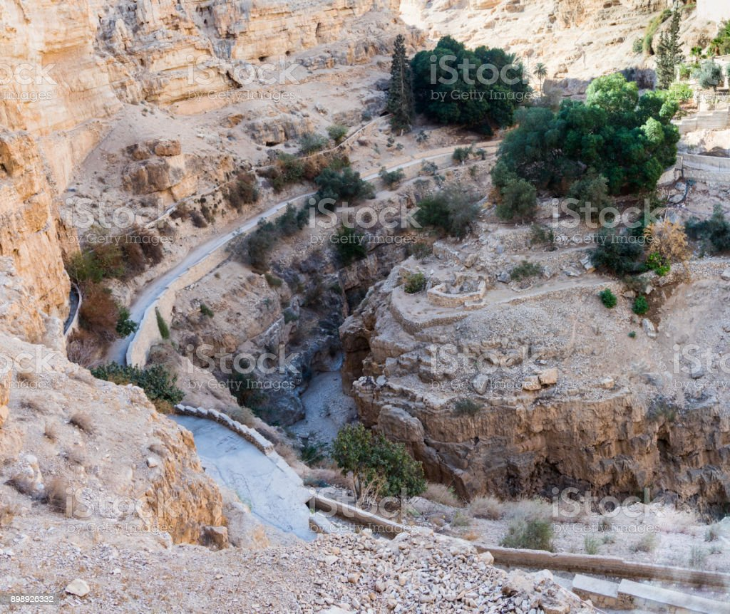 The bed  of the dried-up river at the foot of the monastery of St. George Hosevit (Mar Jaris) in Wadi Kelt near Mitzpe Yeriho in Israel stock photo