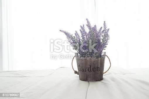 istock The bed with purple lavender flower at bedroom. 610789662