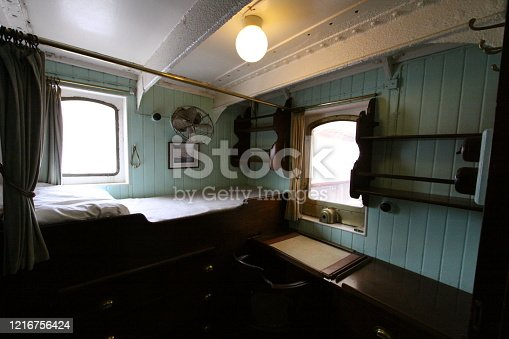 The bedroom in an old cabin boat.