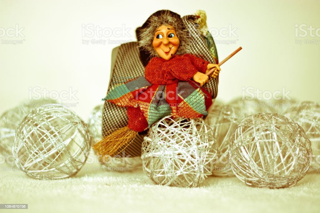 the Befana flying away takes all the Christmas parties - foto stock
