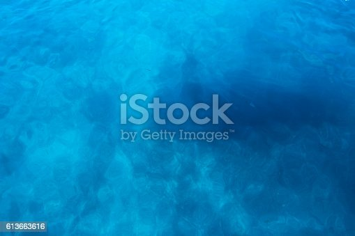 istock The beginning of man metamorphosis in deep dark water 613663616
