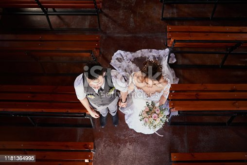 High angle shot of a young couple walking down the aisle on their wedding day