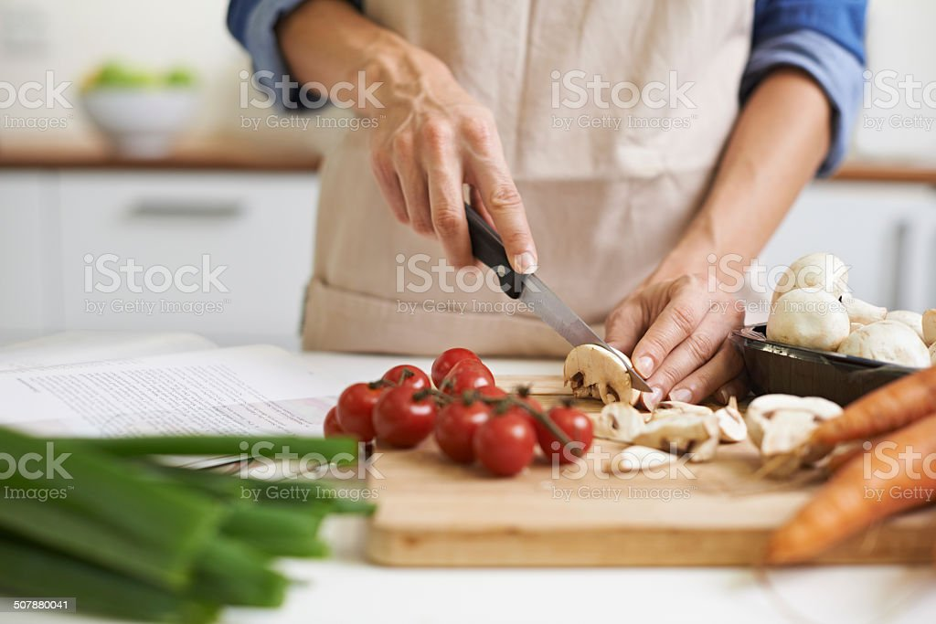 The beginnings of something delicious Cropped shot of a young woman chopping vegetables Adult Stock Photo
