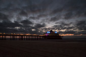 Blankenberge, Belgium - September 10, 2019: The Belgium Pier at dusk. Belgium Pier is a pier in Blankenberge, Belgium. It was built in 1933, the concrete structure stretches 350 meters out into the North Sea.