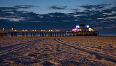 Blankenberge, Belgium - September 10, 2019: The Belgium Pier is a pier in Blankenberge, Belgium. It was built in 1933, the concrete structure stretches 350 meters out into the North Sea.