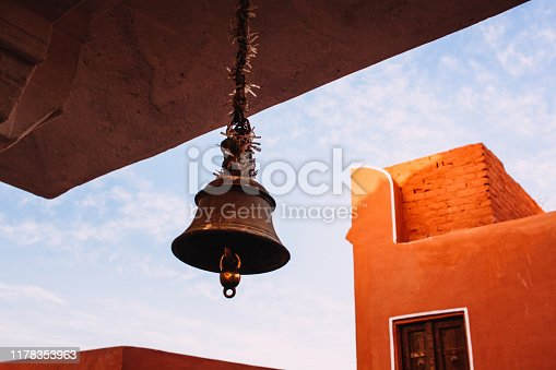 The bell hangs in the Indian temple.
