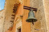The bell of the monastery hangs on the wall