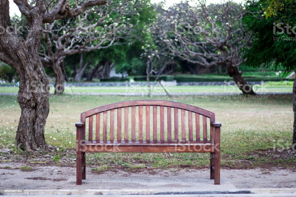 The Bench with backrest roadside in park stock photo