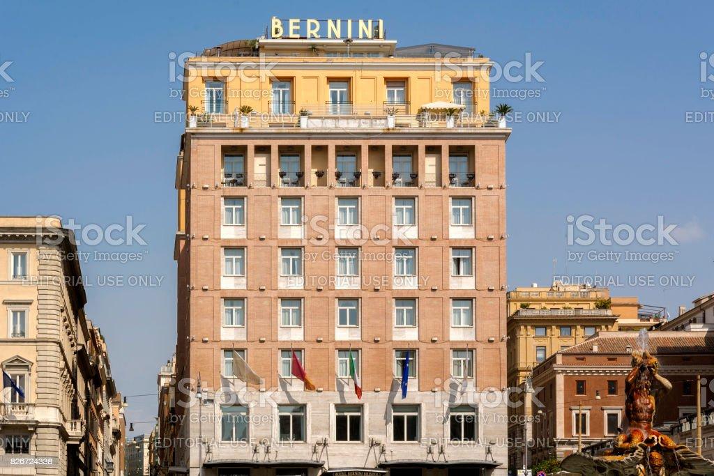 The Bernini Bristol Hotel with the triton statue in Rome stock photo