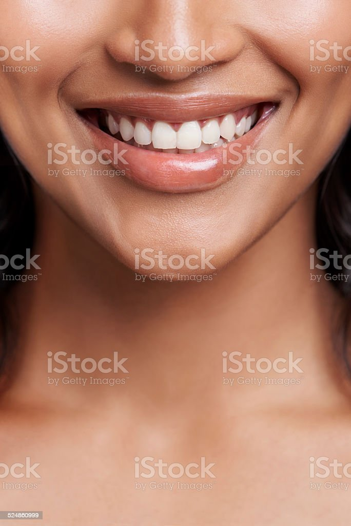 The best curve on your body is your smile stock photo