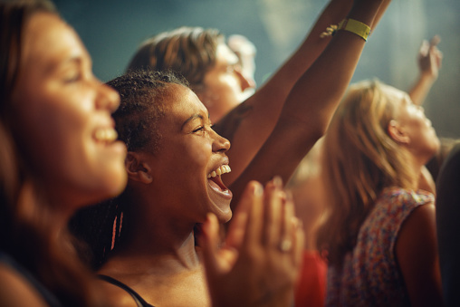 Young girls in an audience enjoying their favourite band's performancehttp://195.154.178.81/DATA/i_collage/pi/shoots/782611.jpg