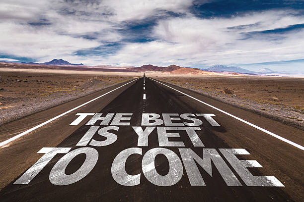 The Best is Yet to Come written on desert road stock photo