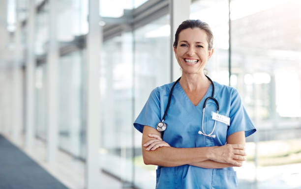The best part about my job is saving lives Shot of a female nurse standing confidently with her arms crossed nurses stock pictures, royalty-free photos & images