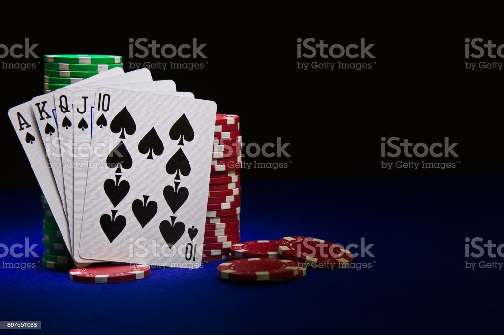 The best poker hand, royal flush with stuck of chips stock photo