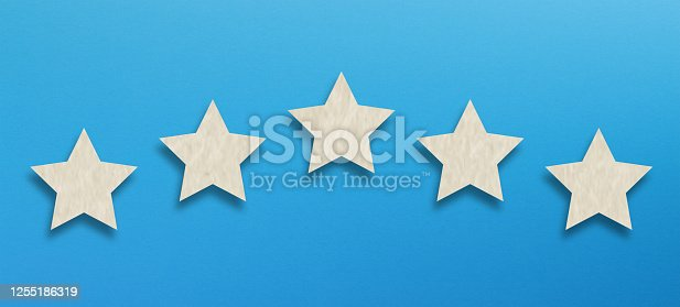 637954680 istock photo The best rating, five white star shape on blue background 1255186319