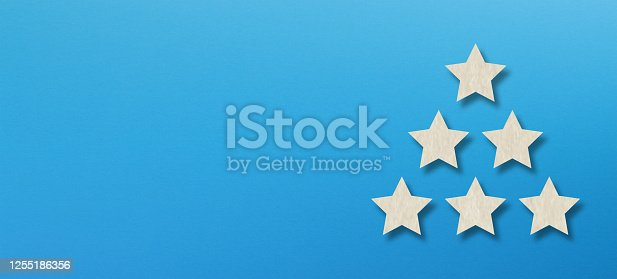 637954680 istock photo The best rating, five white star shape with copy space on blue background 1255186356