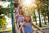 Shot of siblings playing in a playground outdoors