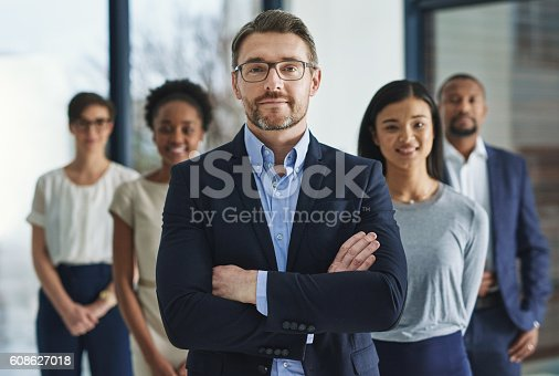 Cropped shot of a group of businesspeople standing in the office
