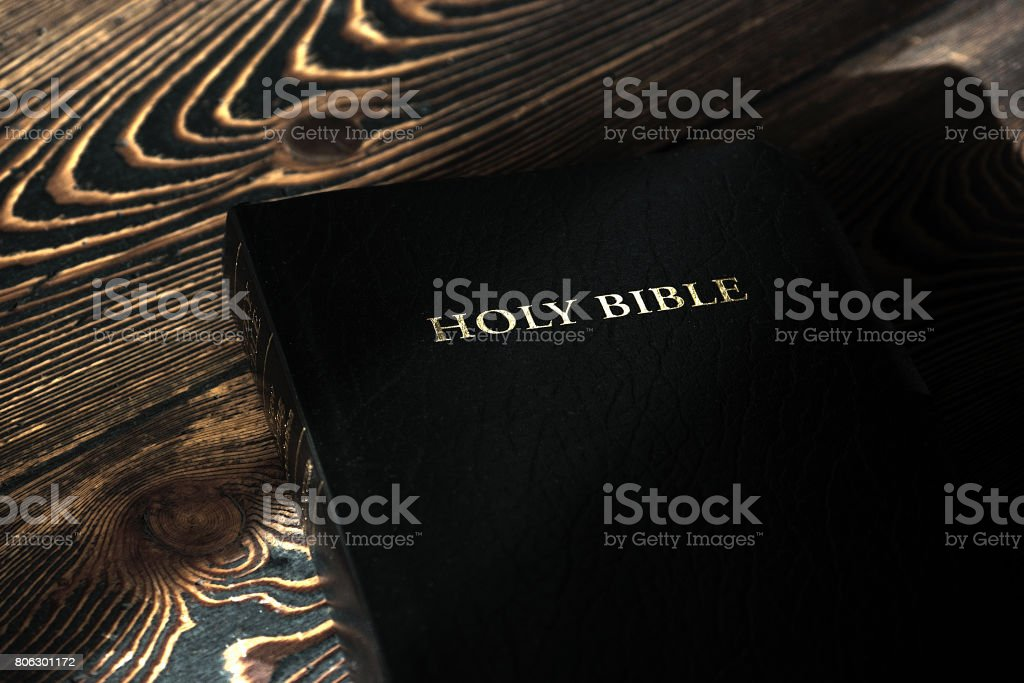 The Bible on the old wooden table, top view stock photo