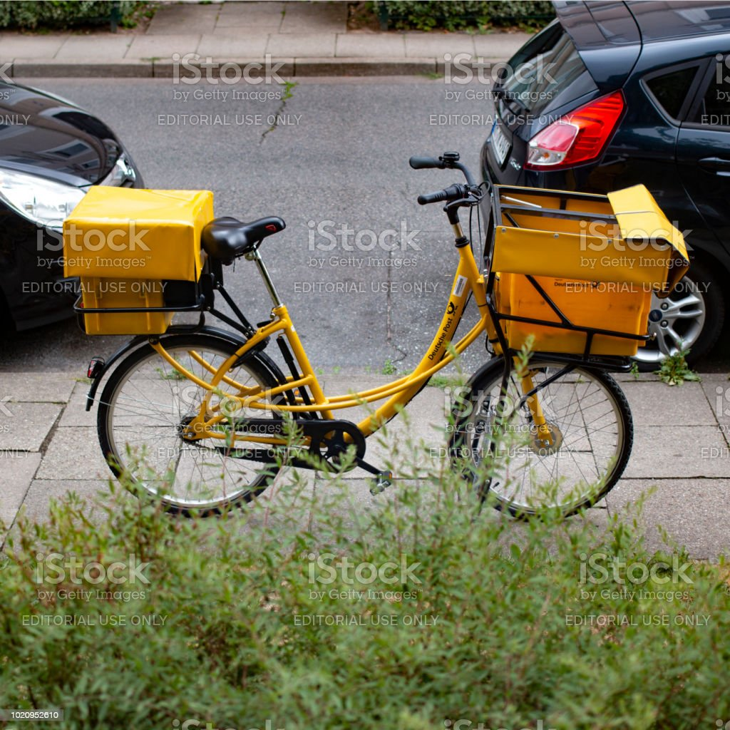The Bicycle Of A Postman Of The German Post Stands On The