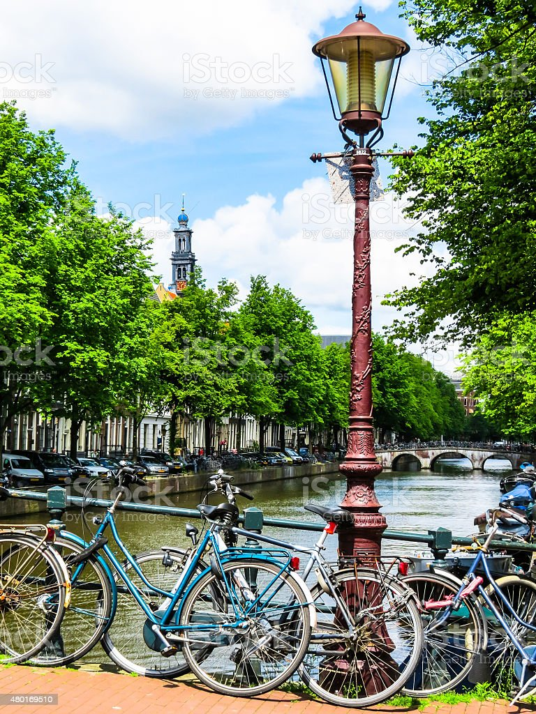 The bicycles and ancient city lamp of the channel stock photo