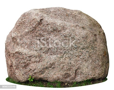 The big ancient mossy granite stone lie on a forest green grass glade. Isolated on white  with patch