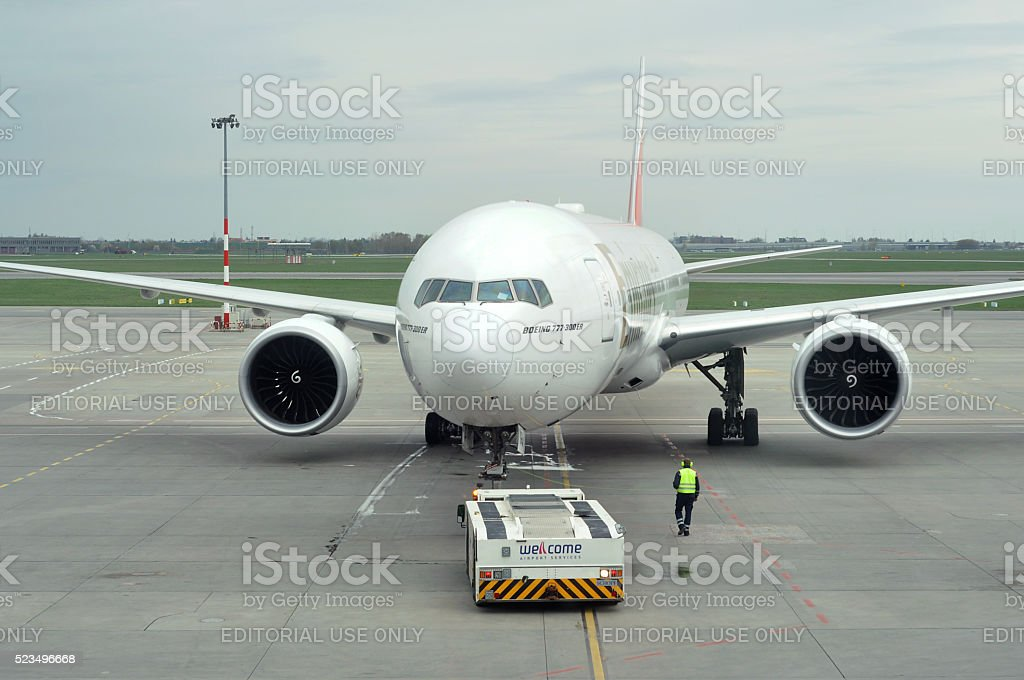 The big Boeing 777-300 in front of window at airport stock photo
