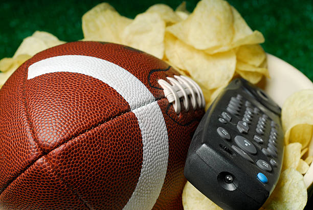 The Big Game is on TV Football with Chip Bowl and TV Remote portable television stock pictures, royalty-free photos & images