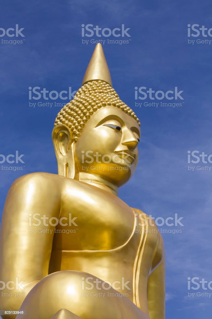 The big golden Buddha statue on hill in thailand stock photo