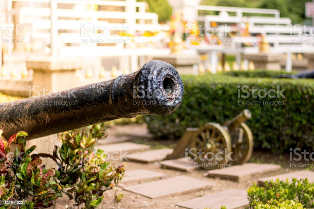 The big old cannon with small cannon in background and sunlight stock photo