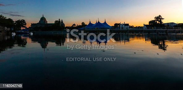 Located on the NUI Galway campus across from the Galway Cathedral, the Heineken Big Top at Fisheries Field is now a famous landmark for the Galway International Arts Festival in its 42nd year on the River Corrib. Eve of 2019 GAIF, Sunday 14th July 2019. Clear sky and the summer in the city like never before promising another absolute Galway season with headliners for the Big Top of the dance act Orbital