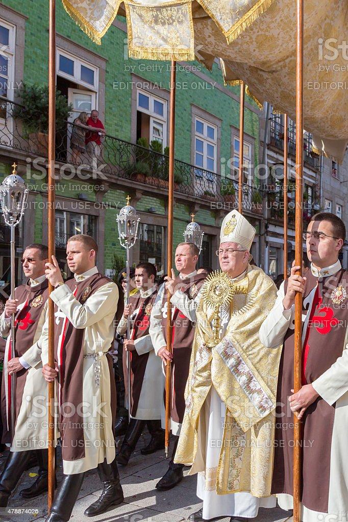 The bishop holding the eucharist at 'São João' procession stock photo
