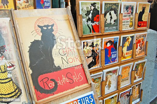Paris, France - October 31, 2012: the famous poster of Le Chat Noir, the black cat, and other french cards for sale in Montmartre, Paris. Le Chat Noir was a famous cabaret club in the 19th century in Montmartre.