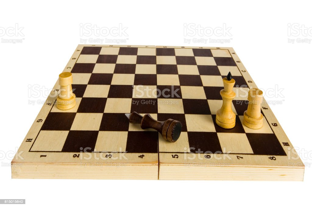 The black chess king is defeated and lies on the board. stock photo