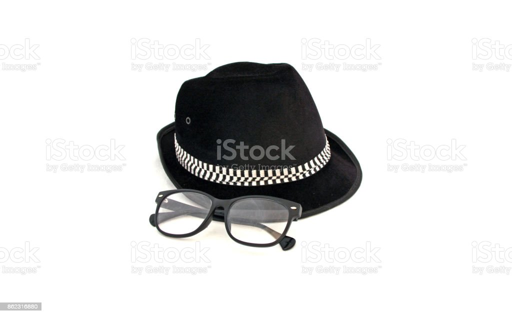The black hat with spectacles on white background. stock photo