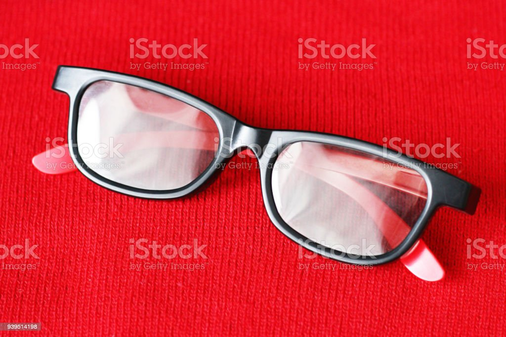 The black rim on the red material, 3D glasses stock photo