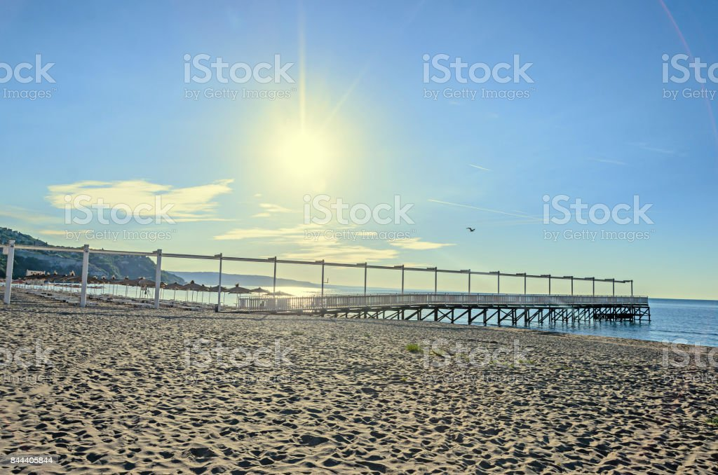 The Black Sea beach from Albena, Bulgaria with golden sands, sun, blue clear water, seaside bridge with kissing points and benches stock photo