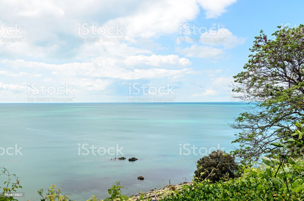The Black Sea blue water view from hills of  Balcik, Bulgaria, fluffy clouds stock photo