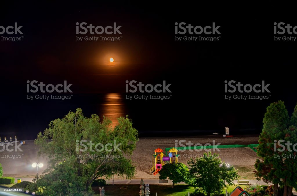 The Black Sea shore from Albena, Bulgaria in night time moon, golden sands, fresh water, sunbeds and umbrellas stock photo