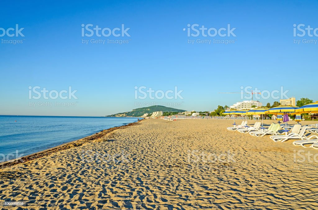The Black Sea shore from Albena, Bulgaria with golden sands, blue fresh water, sunbeds and umbrellas near beach hotels stock photo
