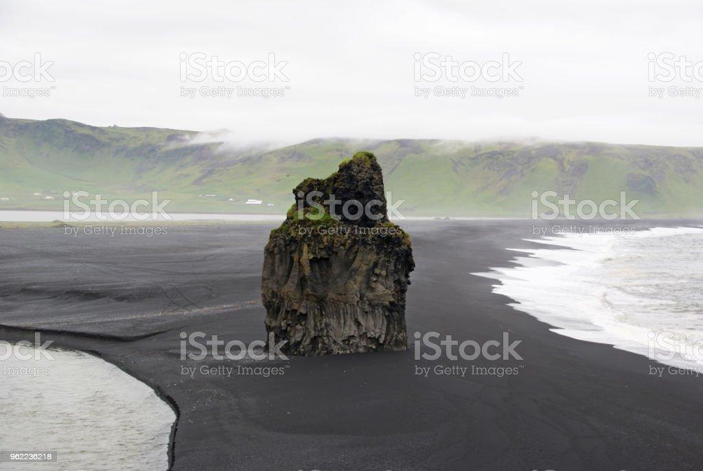 The black stone coast of Atlantic stock photo