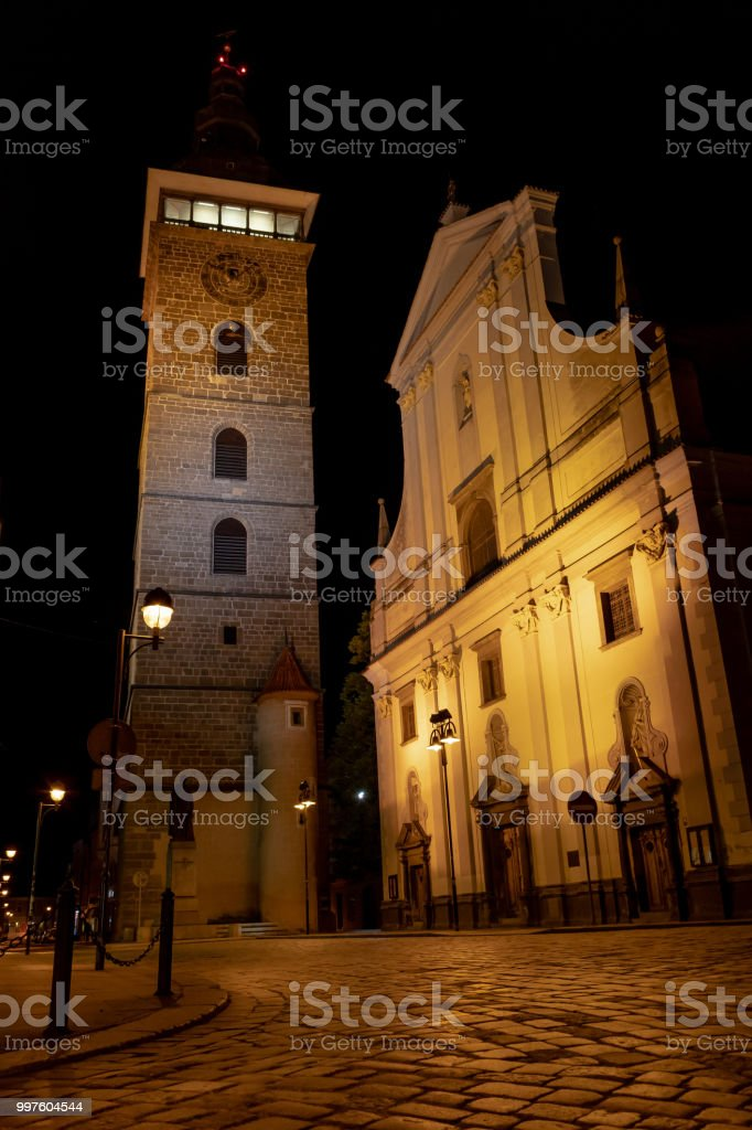 The Black Tower and the Cathedral of St. Nicholas in Budweis stock photo