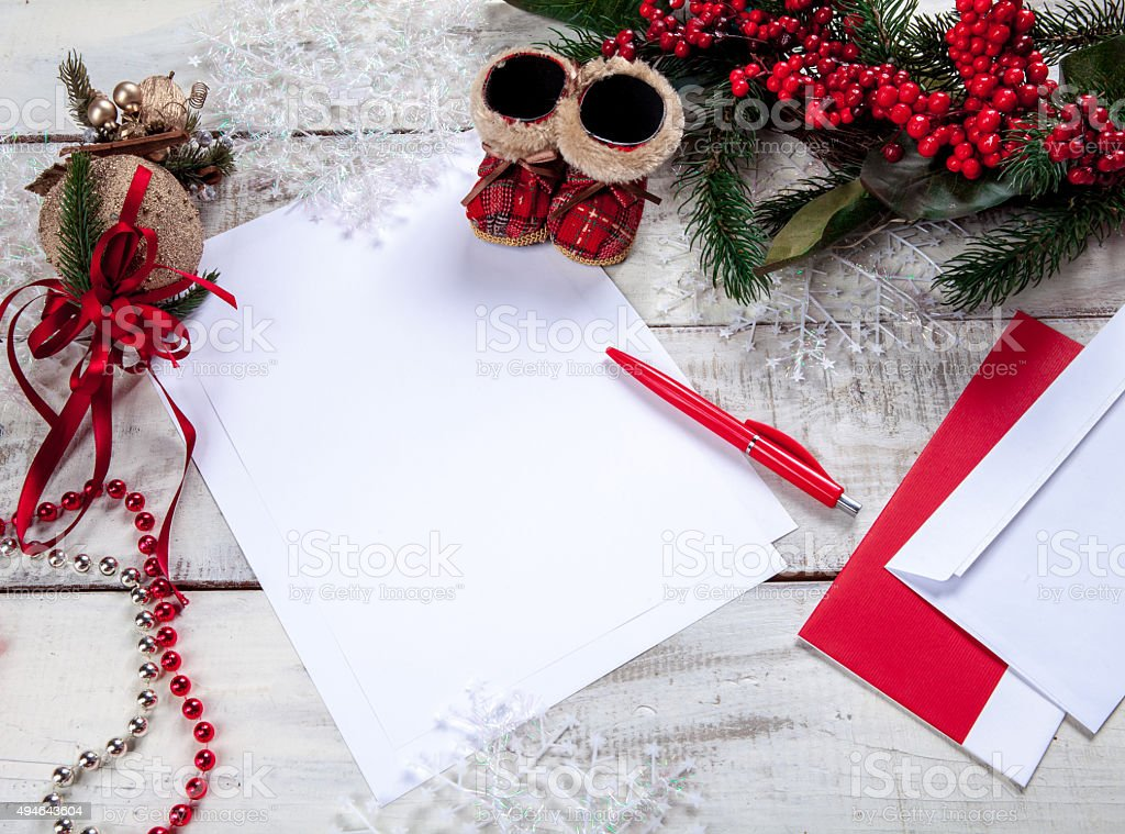 The blank sheet of paper on the wooden table with stock photo