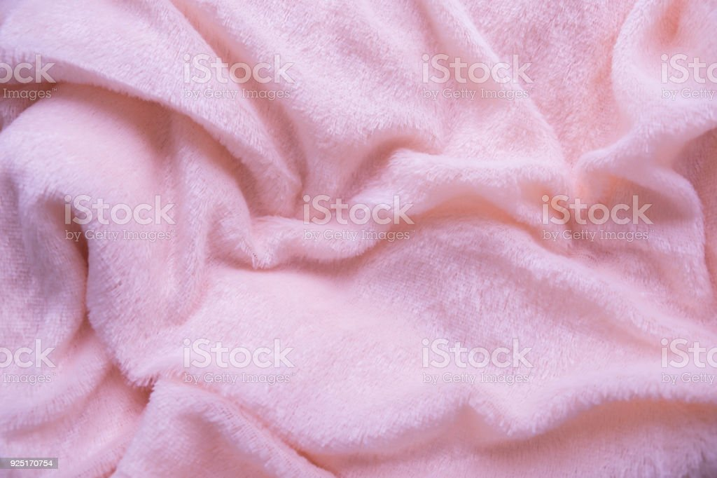 The blanket of furry pink fleece fabric. A background of light pink soft  plush fleece material with a lot of relief folds - Stock image . c07dc17c4