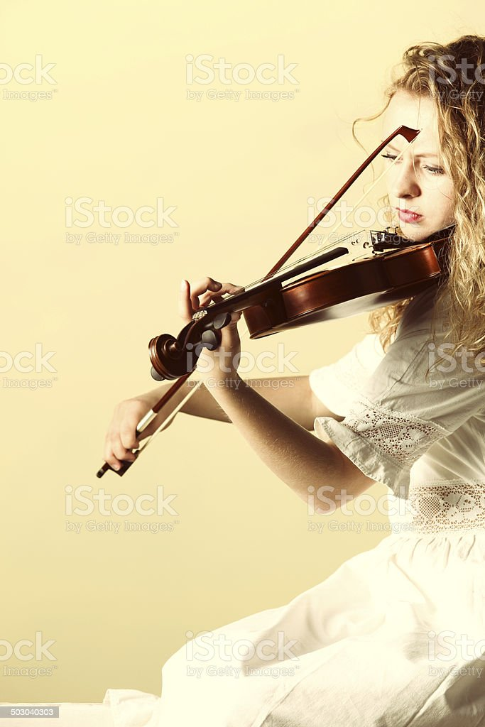 The blonde girl with a violin outdoor stock photo